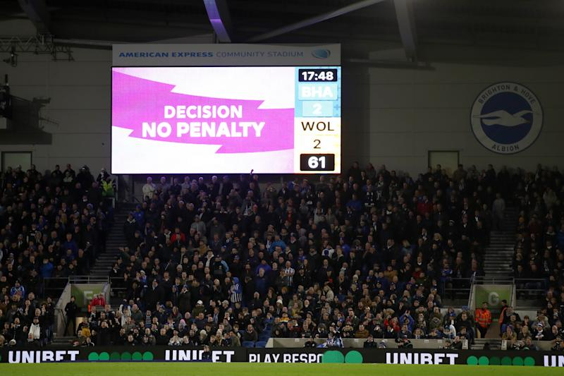 BRIGHTON, ENGLAND - DECEMBER 08: The screen displays no penalty on VAR for a Brighton & Hove Albion handball during the Premier League match between Brighton & Hove Albion and Wolverhampton Wanderers at American Express Community Stadium on December 08, 2019 in Brighton, United Kingdom. (Photo by Bryn Lennon/Getty Images)
