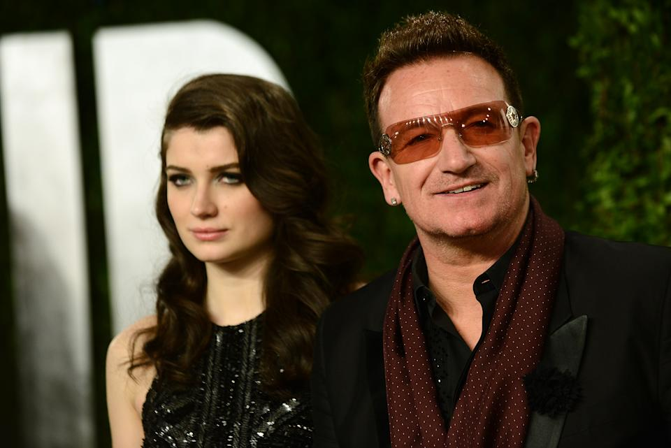 From left, actress Eve Hewson and musician Bono arrive at the 2013 Vanity Fair Oscars Viewing and After Party on Sunday, Feb. 24 2013 at the Sunset Plaza Hotel in West Hollywood, Calif. (Photo by Jordan Strauss/Invision/AP)