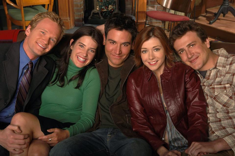 """From left: """"How I Met Your Mother"""" costars Neil Patrick Harris,Cobie Smulders, Josh Radnor, Alyson Hannigan, and Jason Segel sitting together."""