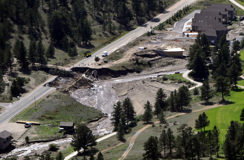 This aerial photo shows flood damage in Greeley Colo. during a helicopter tour by Vice President Joe Biden, Gov. John Hickenlooper, and FEMA officials, of flood-ravaged areas , Monday, Sept. 23, 2013. (AP Photo/The Denver Post, Kathryn Scott Osler, Pool)