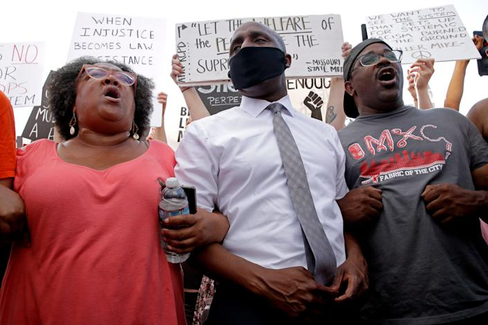 Kansas City Mayor Quinton Lucas, center, stands with protesters Wednesday, June 3, 2020, in Kansas City, Mo., during a unity march to protest against police brutality following the death of George Floyd, who died after being restrained by Minneapolis police officers on May 25.
