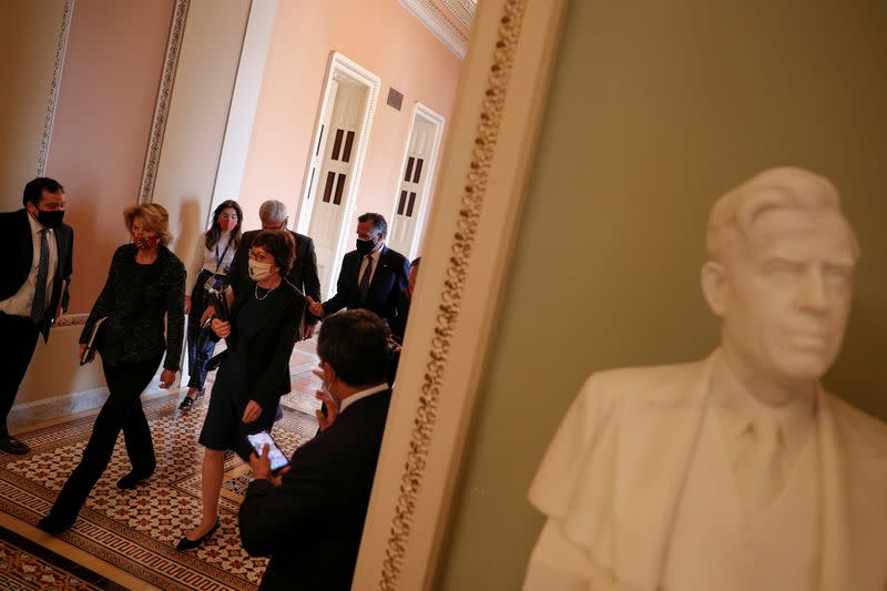 FILE PHOTO: Senators Murkowski, Collins, Romney and Cassidy speak to news reporters following a meeting with Senate Majority Leader McConnell on Capitol Hill in Washington