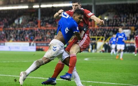 Rangers Alfredo Morelos (left) and Aberdeen's Scott Mckenna clash, resulting in them both receiving a red card during the Ladbrokes Scottish Premiership match at Pittodrie Stadium, Aberdeen - Credit: PA