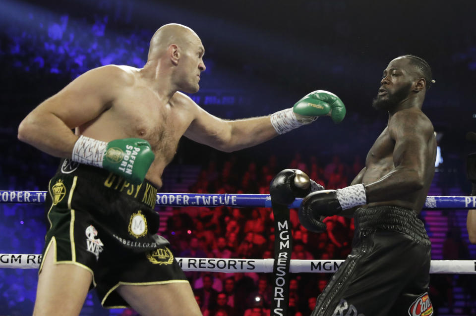 Tyson Fury, left, of England, fight Deontay Wilder during a WBC heavyweight championship boxing match Saturday, Feb. 22, 2020, in Las Vegas. (AP Photo/Isaac Brekken)