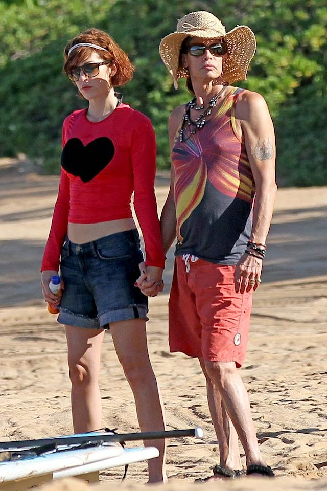 "Dude looks like a lady? Always a fan of feminine fashion, ""Aerosmith"" frontman Steven Tyler, 63, donned a tank top, ladies' straw hat, and nail polish during his vacation in Hawaii this week, where the rocker was joined by his 38-year-old girlfriend Erin Brady, and fellow bandmates Joe Perry and Joey Kramer. (11/15/2011)"