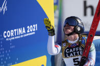 United States' Breezy Johnson gestures after she gets to the finish area after completing the women's downhill, at the alpine ski World Championships in Cortina d'Ampezzo, Italy, Saturday, Feb. 13, 2021. (AP Photo/Giovanni Auletta)