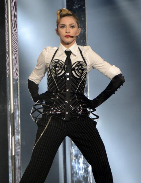"<div class=""caption-credit""> Photo by: Getty Images</div><div class=""caption-title""></div><b>""MDNA"" tour in Israel, May 2012</b> <br> Jean Paul Gautier helps Madge resurrect the cone bra in a new, masculine-meets-feminine ensemble. Personally we'd squeal to see her take the stage in the original look, but this is cool too."
