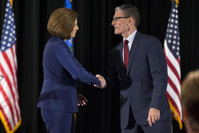 Democratic Senate candidate Catherine Cortez Masto shakes hands with U.S. Rep. Joe Heck, R-Nev., after the Nevada Senatorial Debate at Canyon Springs High School on Friday, Oct. 14, 2016, in North Las Vegas. The debate was televised statewide. (Photo: Erik Verduzco/Las Vegas Review-Journal via AP)