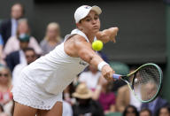 Australia's Ashleigh Barty plays a return to Germany's Angelique Kerber during the women's singles semifinals match on day ten of the Wimbledon Tennis Championships in London, Thursday, July 8, 2021. (AP Photo/Kirsty Wigglesworth)