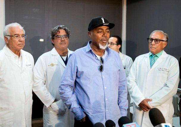 PHOTO: Accompanied by the medical team, the father of former Red Sox player David Ortiz, Leo Ortiz, speaks to the press, June 10, 2019, during a press conference at the clinic where David was admitted after being shot in Santo Domingo, Dominican Republic. (Erika Santelices/AFP/Getty Images)