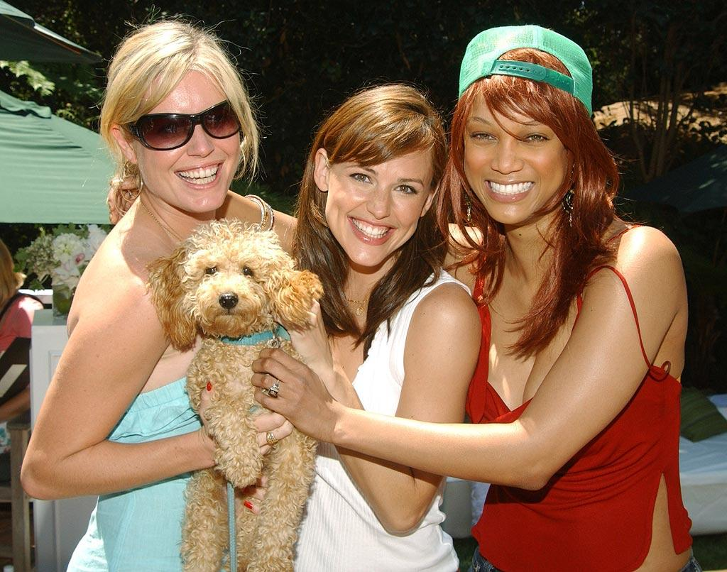 "Rebecca Romijn and her dog Better pose with Jennifer Garner and Tyra Banks. Amy Graves/<a href=""http://www.wireimage.com"" target=""new"">WireImage.com</a> - August 8, 2004"