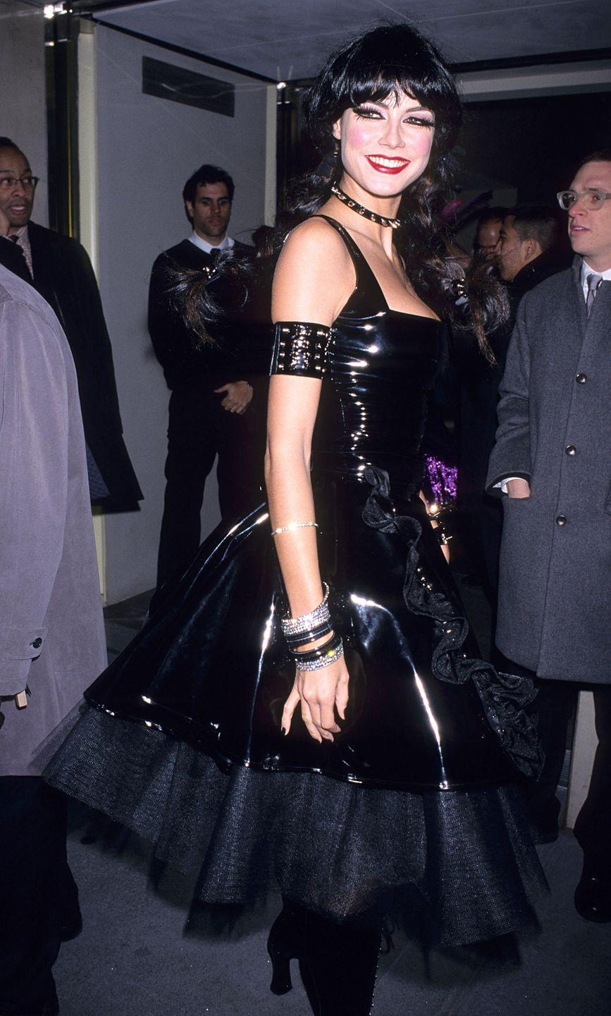 <p>The model wore an SNM-inspired black dress for one of her earliest Halloween bashes with two Pippi Longstocking braids</p>