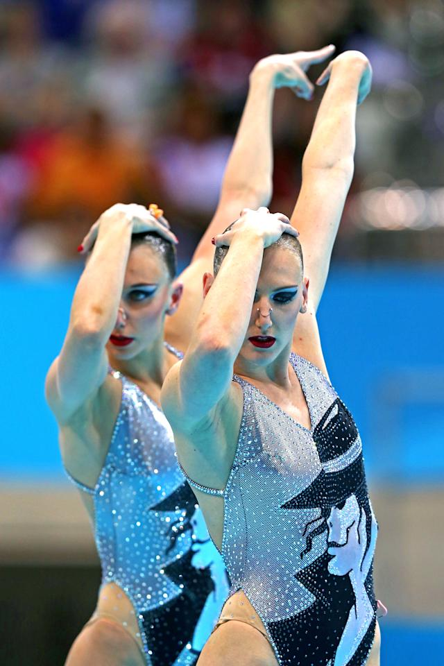 Natalia Ischenko and Svetlana Romashina of Russia compete in the Synchronised Swimming - Duets - Technical Routine on Day 9 of the London 2012 Olympic Games at the Aquatics Centre  on August 5, 2012 in London, England.  (Photo by Clive Rose/Getty Images)