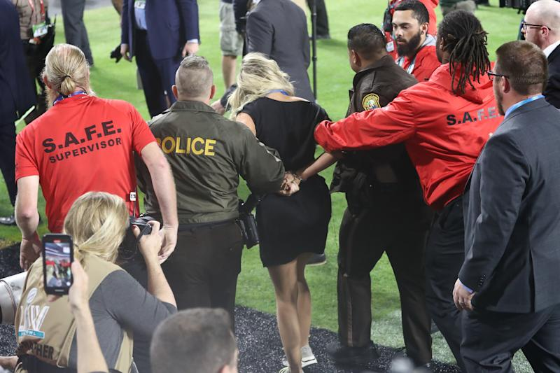 MIAMI, FLORIDA - FEBRUARY 02: A fan is detained after running on the field in Super Bowl LIV between the San Francisco 49ers and the Kansas City Chiefs at Hard Rock Stadium on February 02, 2020 in Miami, Florida. (Photo by Ronald Martinez/Getty Images)
