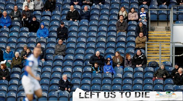Soccer Football - FA Cup Second Round - Blackburn Rovers vs Crewe Alexandra - Ewood Park, Blackburn, Britain - December 3, 2017 General view of empty seats as Blackburn fans display a banner during the game Action Images/Carl Recine