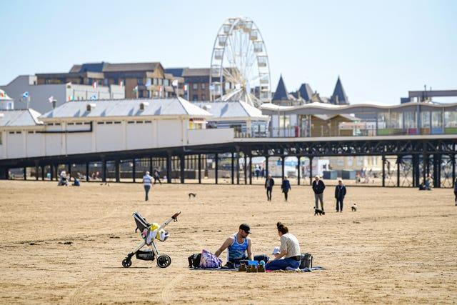 People relax on the beach at Weston-super-Mare, Somerset (Ben Birchall/PA)