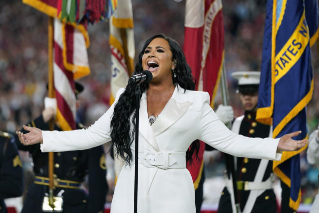 FILE - In this Feb. 2, 2020, file photo, Demi Lovato performs the national anthem before the NFL Super Bowl 54 football game in Miami Gardens, Fla. Bubba Wallace now counts Spike Lee and Demi Lovato his admitted celebrity crush as those loudly in his corner since hes become the leader of NASCARs push for change. (AP Photo/David J. Phillip, File)