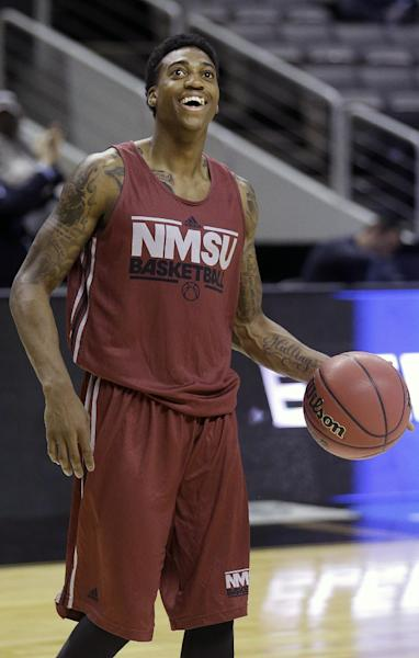 New Mexico State guard Daniel Mullings (23) smiles during practice for a second-round NCAA college basketball tournament game in San Jose, Calif., Wednesday, March 20, 2013. New Mexico State is scheduled to face Saint Louis on Thursday. (AP Photo/Jeff Chiu)
