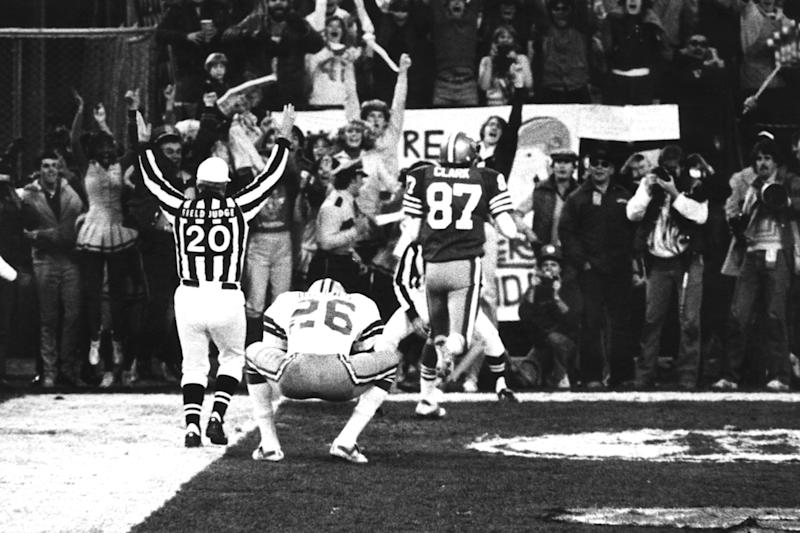 Wide receiver Dwight Clark of the San Francisco 49ers leaves a Dallas defender in his dust after making 'The Catch' to defeat the Dallas Cowboys 28-27 in the 1981 NFC Championship Game on January 10, 1982 at Candlestick Park in San Francisco, California. (Photo by Arthur Anderson/Getty Images) *** Local Caption ***
