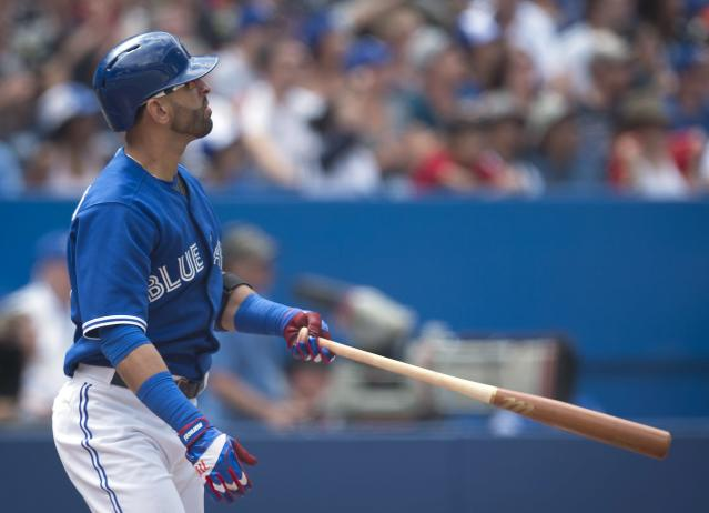 Toronto Blue Jays' Jose Bautista watches his solo home run in the sixth inning of a baseball game against the New York Yankees in Toronto, Sunday, Aug. 31, 2014. (AP Photo/The Canadian Press, Darren Calabrese)