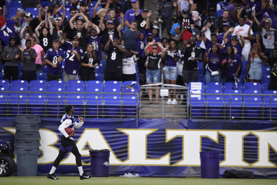 Baltimore Ravens' Marlon Humphreys looks to fans before throwing an autographed football, after practice at NFL football training camp Saturday, July 31, 2021, in Baltimore. (AP Photo/Gail Burton)