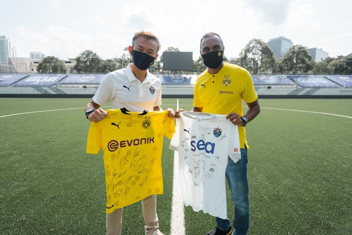 Lion City Sailors chief executive officer Chew Chun-Liang (left) and Suresh Letchmanan (right), managing director of Borussia Dortmund Asia Pacific, commemorating the signing of the official partnership of the two clubs. (PHOTO: Lion City Sailors FC)