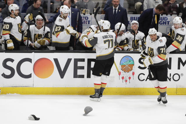 Vegas Golden Knights center William Karlsson (71) celebrates after his hat trick against the Anaheim Ducks during the third period of an NHL hockey game in Anaheim, Calif., Sunday, Feb. 23, 2020. (AP Photo/Chris Carlson)