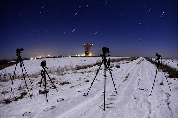 The night sky over the Galenki RT-70 radio telescope at a Kvant-D command and measurement complex which is part of the Titov Main Space Test Centre, during the Geminids meteor shower. (Photo by Yuri Smityuk\TASS via Getty Images)