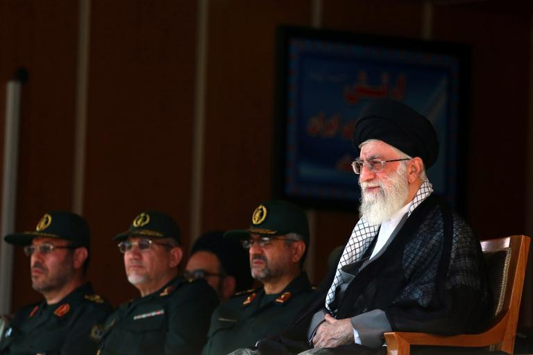 A handout picture released by the official website of Iran's supreme leader, Ayatollah Ali Khamenei, shows him (R) during a visit to the Military College of Tehran on October 5, 2013