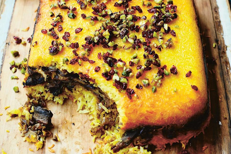 """This beautiful, saffron-infused savory rice cake is a regional specialty from Shiraz in central Iran. Traditionally it is made with poached chicken, but this vegetarian alternative swaps in rich and earthy portobello mushrooms and meaty eggplants. Tahcheen is a great dish to make if you are entertaining, as you can prepare everything in advance and then simply put it in the oven a few hours before your guests arrive. <a href=""""https://www.epicurious.com/recipes/food/views/eggplant-and-mushroom-tahcheen?mbid=synd_yahoo_rss"""" rel=""""nofollow noopener"""" target=""""_blank"""" data-ylk=""""slk:See recipe."""" class=""""link rapid-noclick-resp"""">See recipe.</a>"""