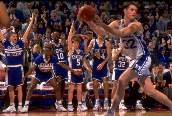 Duke's Christian Laettner (32) in action in front of Kentucky bench during game at The Spectrum. (Getty)