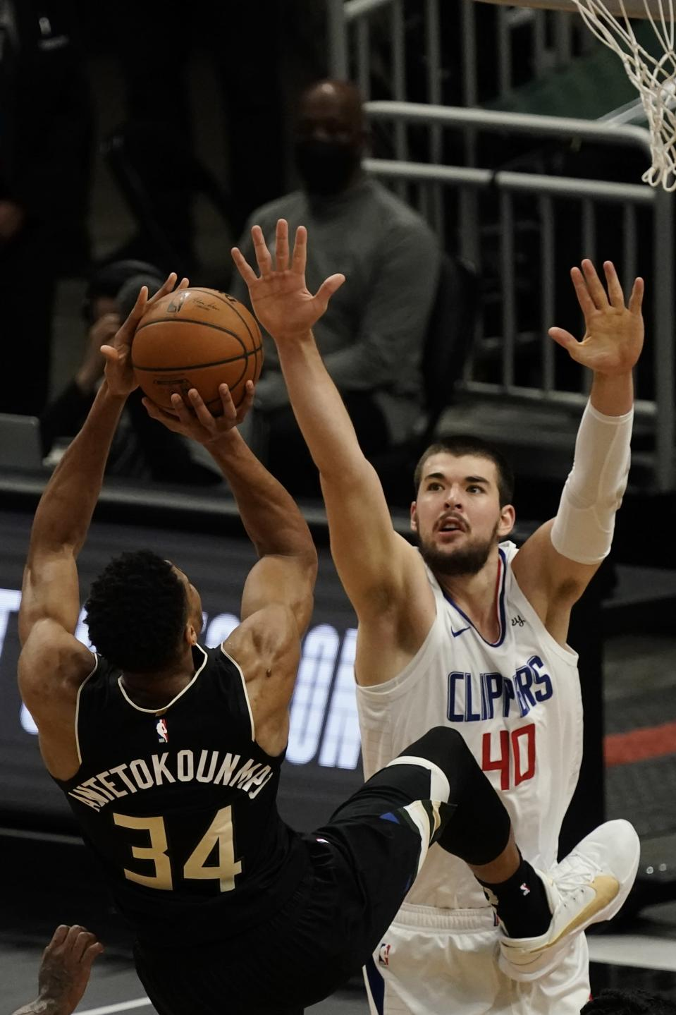 Milwaukee Bucks' Giannis Antetokounmpo is fouled as he shoots against LA Clippers' Ivica Zubac during the first half of an NBA basketball game Sunday, Feb. 28, 2021, in Milwaukee. (AP Photo/Morry Gash)