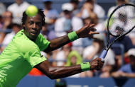 Gael Monfils, of France, returns a shot to Alejandro Gonzalez, of Colombia, during the second round of the 2014 U.S. Open tennis tournament, Friday, Aug. 29, 2014, in New York. (AP Photo/Elise Amendola)