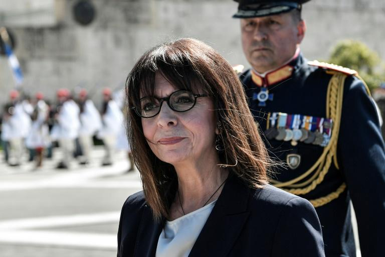 Greece's first woman President Katerina Sakellaropoulou vows to defend borders and rights but warns also of the need to tame the coronavirus crisis