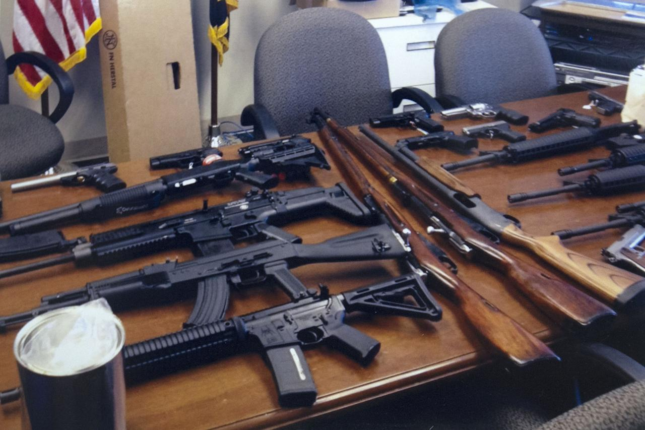 This handout photo provided by the Prince George's, Md. County Police shows weapons found in the possession of a suspect who they say was plotting a shooting in his workplace. (AP Photo/Prince George's County Police)