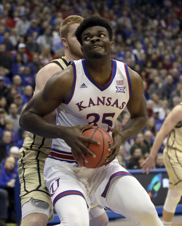 Kansas center Udoka Azubuike (35) drives to the basket past Wofford center Matthew Pegram, back, during the first half of an NCAA college basketball game in Lawrence, Kan., Tuesday, Dec. 4, 2018. (AP Photo/Orlin Wagner)