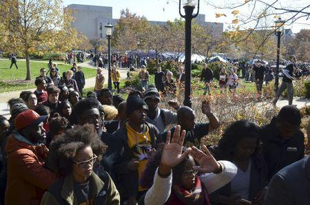 Students listen at a press conference at Traditions Plaza at Carnahan Quad, on the University of Missouri campus in Columbia, Missouri, November 9, 2015. REUTERS/The Maneater/Elizabeth Loutfi