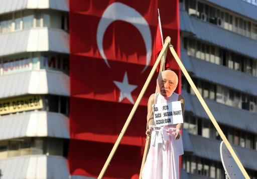 Turkey issues warrant for preacher Gulen over coup