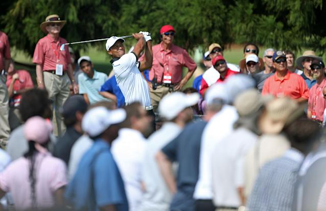 Tiger Woods hits from the the second tee during the second round of the Tour Championship golf tournament at East Lake Golf Club in Atlanta, Friday, Sept. 20, 2013. (AP Photo/Atlanta Journal-Constitution, Jason Getz)