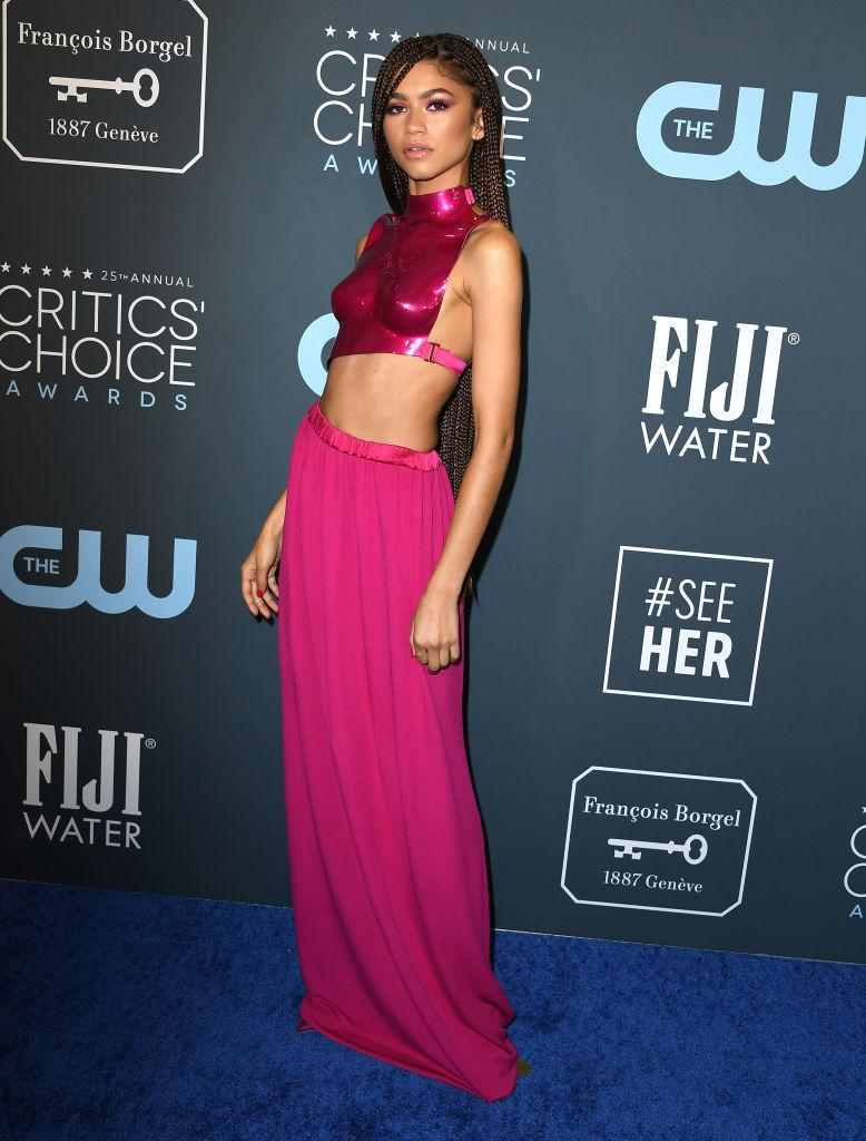 The actress had a fashion moment in a hot-pink breastplate at the Critics' Choice Awards in January, 2020. (Getty Images)