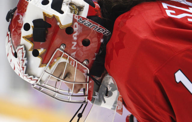 Goalkeeper Shannon Szabados of Canada (1) reacts after a third period goal by the USA during the women's gold medal ice hockey game at the 2014 Winter Olympics, Thursday, Feb. 20, 2014, in Sochi, Russia. (AP Photo/Mark Humphrey)