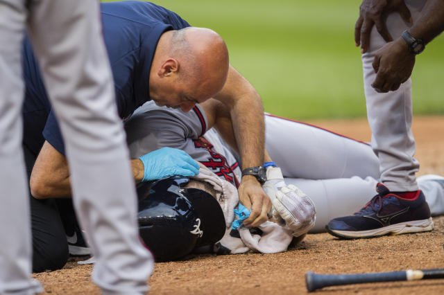 Atlanta Braves Charlie Culberson drops on the ground after getting hit by a ball during the seventh inning of a baseball game against the Washington Nationals in Washington, Saturday, Sept. 14, 2019. (AP Photo/Manuel Balce Ceneta)