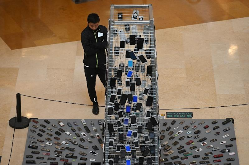 Displayed in a shopping mall in Beijing, the sculpture attracted scores of curious bystanders (AFP Photo/GREG BAKER)