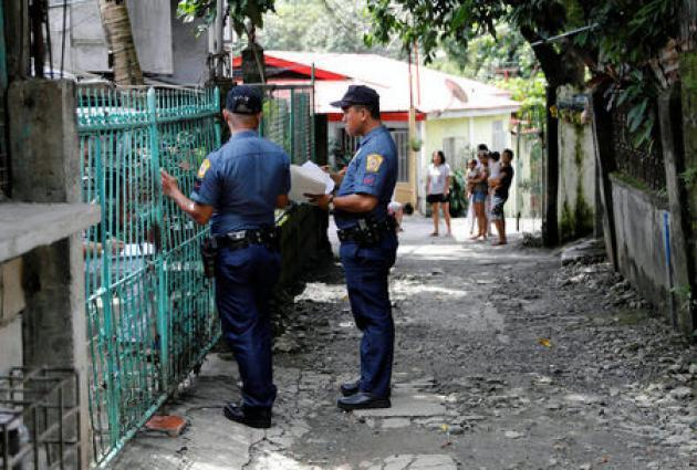 As anger simmers over killings, Philippine police do house-to-house drug tests