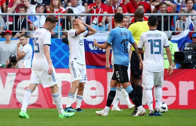 Soccer Football - World Cup - Group A - Uruguay vs Russia - Samara Arena, Samara, Russia - June 25, 2018 Russia's Igor Smolnikov reacts as he is shown a red card by referee Malang Diedhiou REUTERS/Pilar Olivares