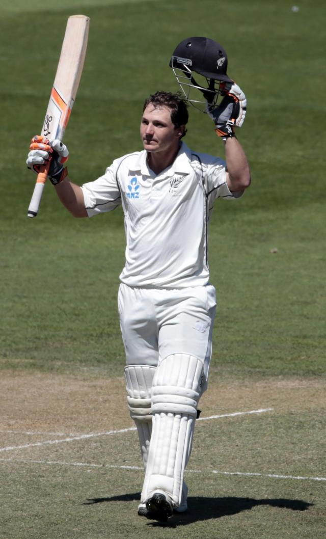 New Zealand's BJ Watling acknowledges his 100 against India during the second innings on day four of the second international test cricket match at the Basin Reserve in Wellington, February 17, 2014. REUTERS/Anthony Phelps (NEW ZEALAND - Tags: SPORT CRICKET)