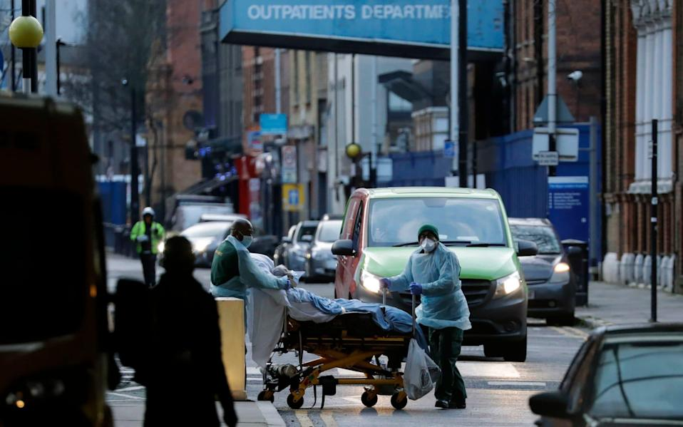 Thousands of non-covid patients will be discharged early under the 'home and hotel' plan - Matt Dunham/AP