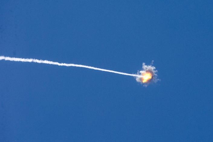 A missile launched by Israel's Iron Dome defence system intercepts and destroys a rocket launched from Gaza into Israel on August 22, 2014 (AFP Photo/Jack Guez)