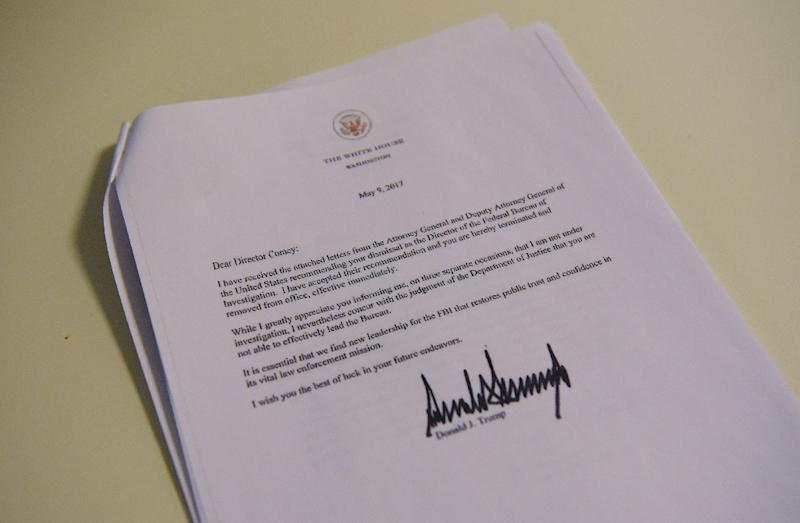 A copy of the termination letter to FBI Director James Comey from US President Donald Trump is seen at the White House on May 9, 2017 in Washington, DC (AFP Photo/MANDEL NGAN)