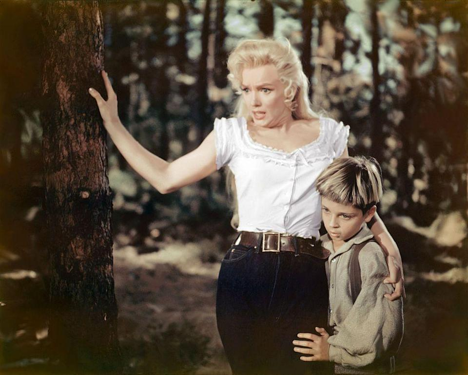 <p>Marilyn Monroe looked rustic and stylish for her role in <em>River of No Return</em> in 1954. The Hollywood actress wore dark high-waisted jeans, a white cotton shirt, and a wide, brown belt. </p>